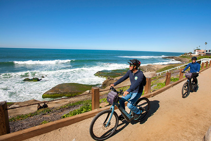 Riding bikes along the bike trail overlooking the San Diego coast