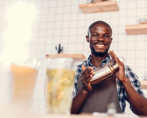 young african american man with cocktails and a shaker