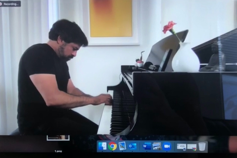 man playing piano over video chat