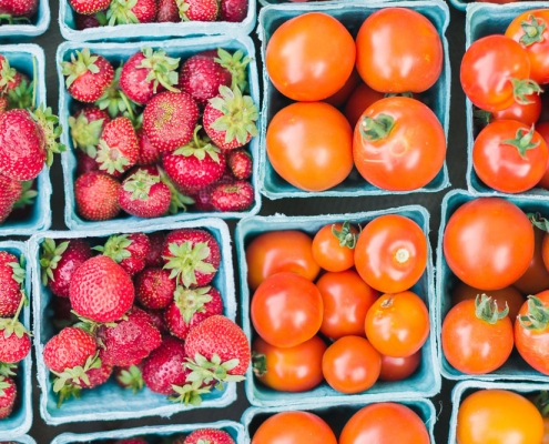 strawberries and tomatoes in cartons